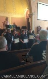 Members receive their certificates of appreciation at the First Responder Service